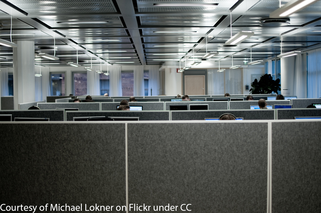 Office filled with employees working at cubicles