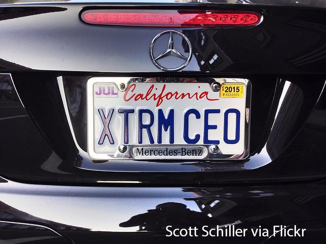CEO driving a Mercedes-Benz