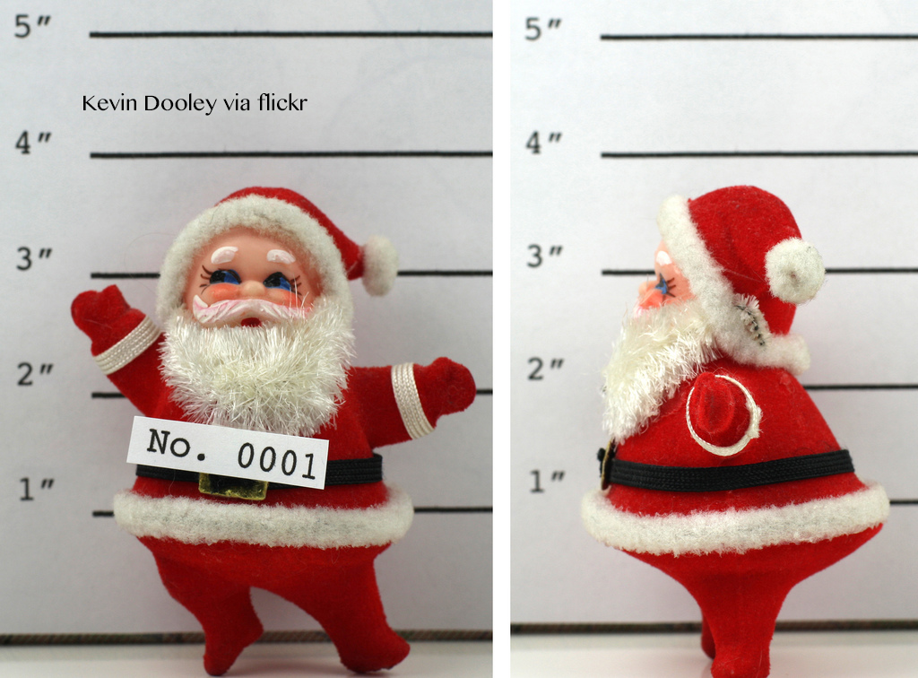 A santa doll getting his picture taken