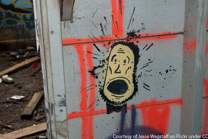 A spray painted surprised face