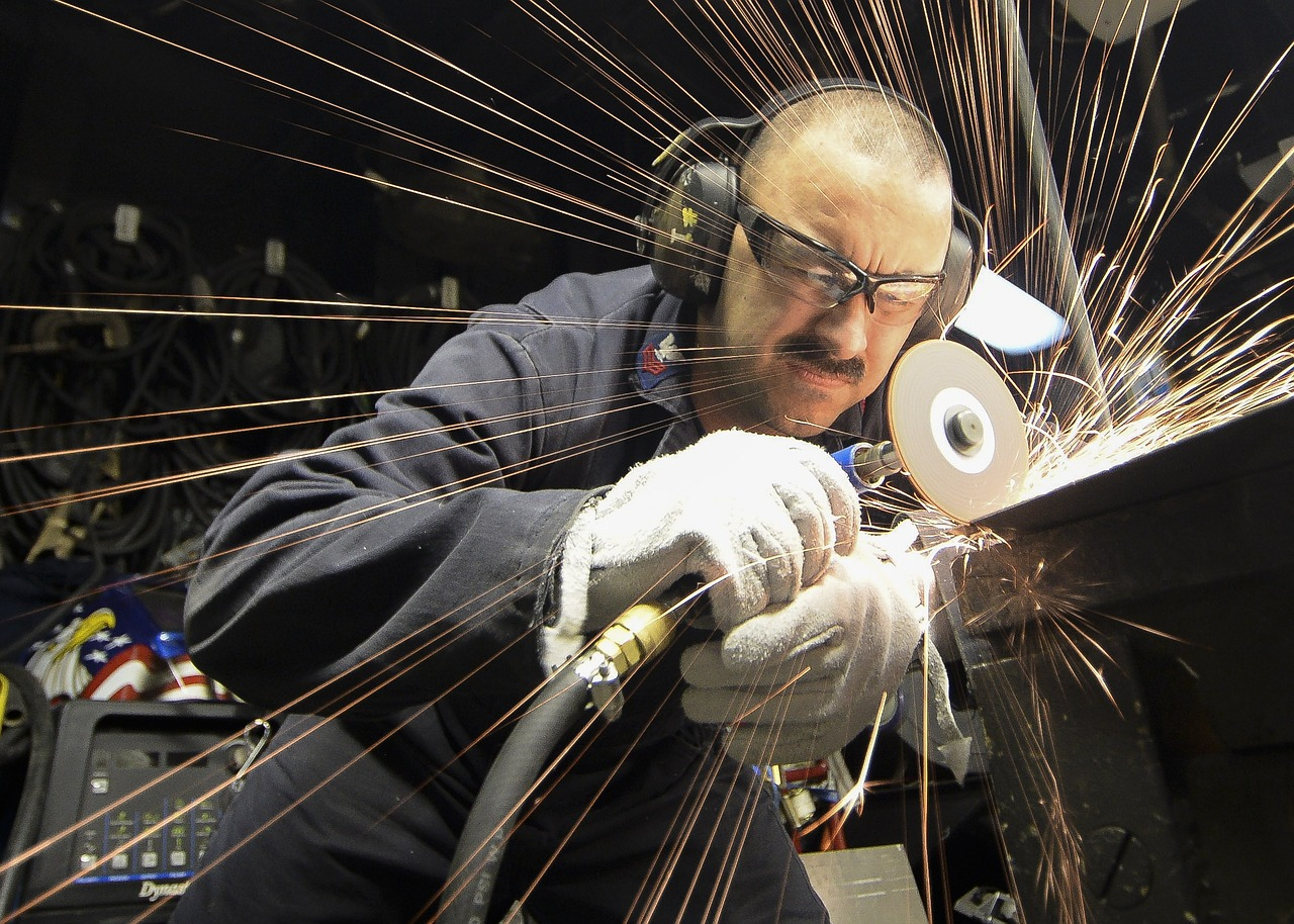 Steel worker using a saw